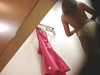 Spy cam in changing room shows girls getting naked