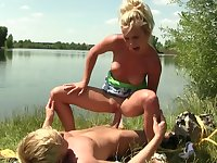 Outdoor fun with a big dick for a naked blonde amateur