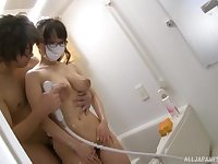 Hamaguchi Ena blows friend's penis before an tit fuck in the bathroom