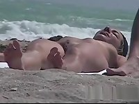 Stunning tanned brunette with a neat pussy in a beach porno
