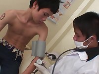 In the medical exam room, the kinky doctor begins assessing his skinny Asian patient