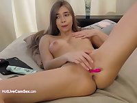 Cute innocent 18-years-old squirts gently on live cam
