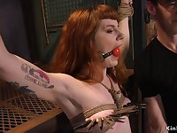 Gagged redhead on all fours fornicateed in bdsm threesome orgy