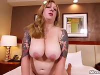 Inked mommy with big natural breasts