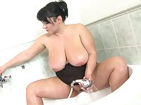 Kinky BBW likes to rub her wet pussy while she's showering