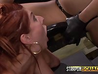 Redhead takes a deep strapon fucking from mistress