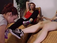 Lovely female foot slave likes licking sexy dominas feet